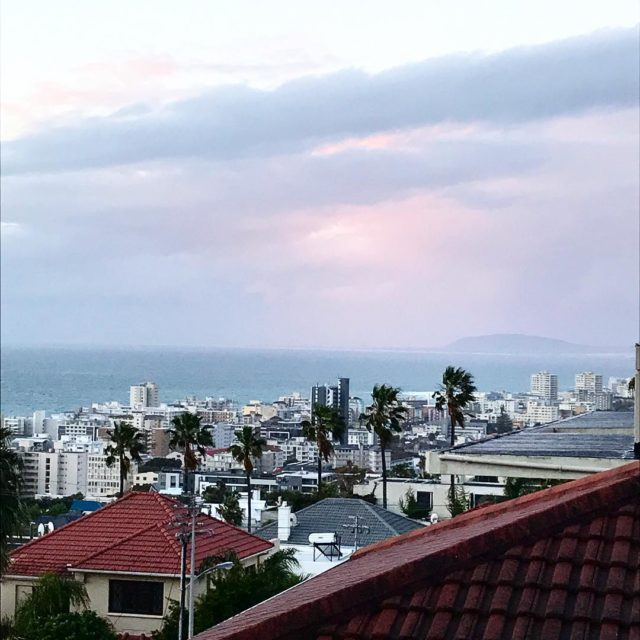 pink blue sunset unfiltered tonight over seapoint from Fresnaye capetownhellip